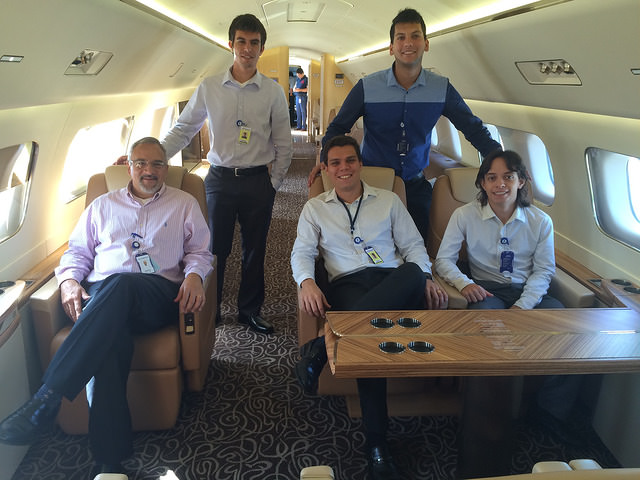 Bruno inside a luxury aircraft with the Embraer team