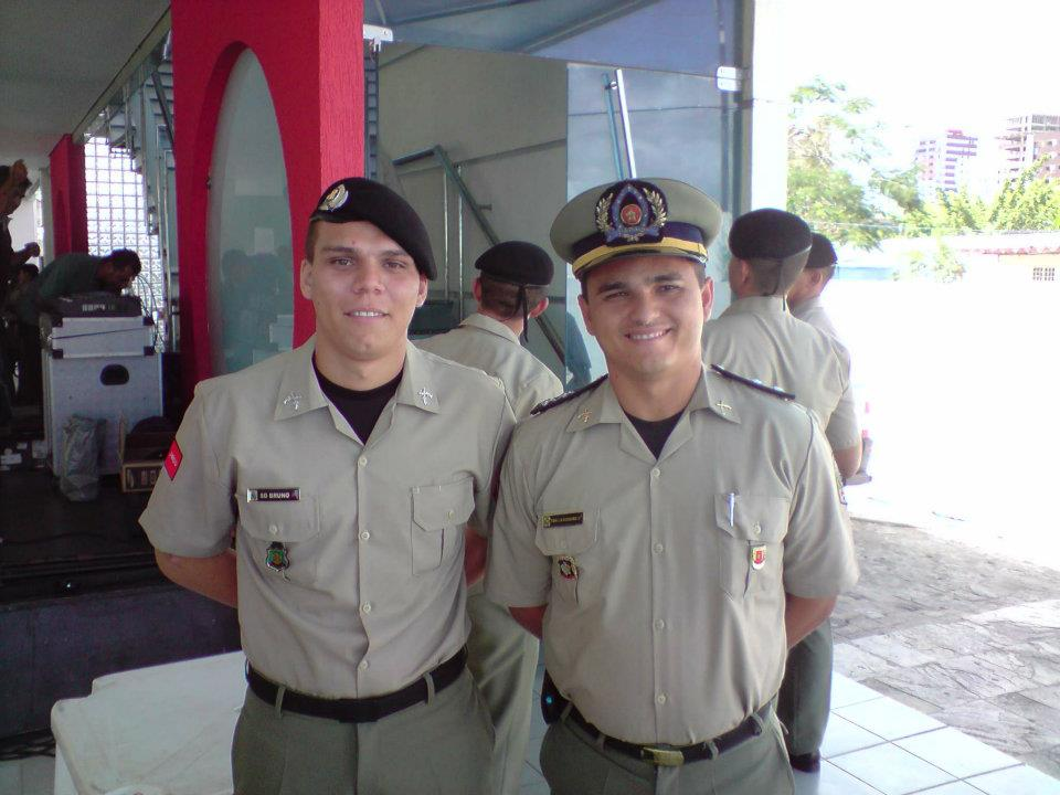 Bruno and hist colegue using the Police uniform in a celebration in Brazil